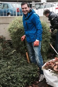 Oliver Cooper gardening at the gardens on Pond Street outside the Royal Free Hospital